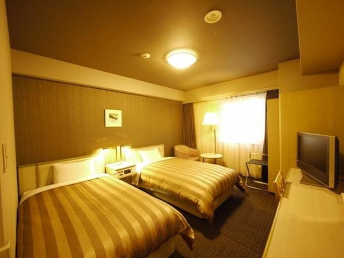 ツインルーム19.5平米。ベッド幅110cm