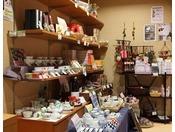 地元のお菓子や旅館で使っている食器など販売しております。