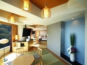 スイート ジャパニーズモダン 107平米伝統的な和テイストを現代風にアレンジした空間。より幅広い年代のお客さまにくつろいでいただける和洋室タイプです。