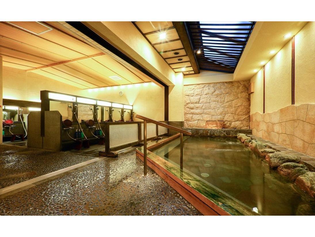 大浴場(一例)、天然鉱石「光明石」を泉源体とする人工温泉です。やわらかい湯ざわりと湯冷めしにくいポカポカ感をお楽しみ下さい。