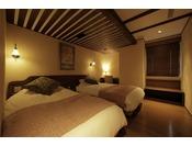リビングとは別に寝室もご用意。当館では全てシモンズのベッドを使用しています。