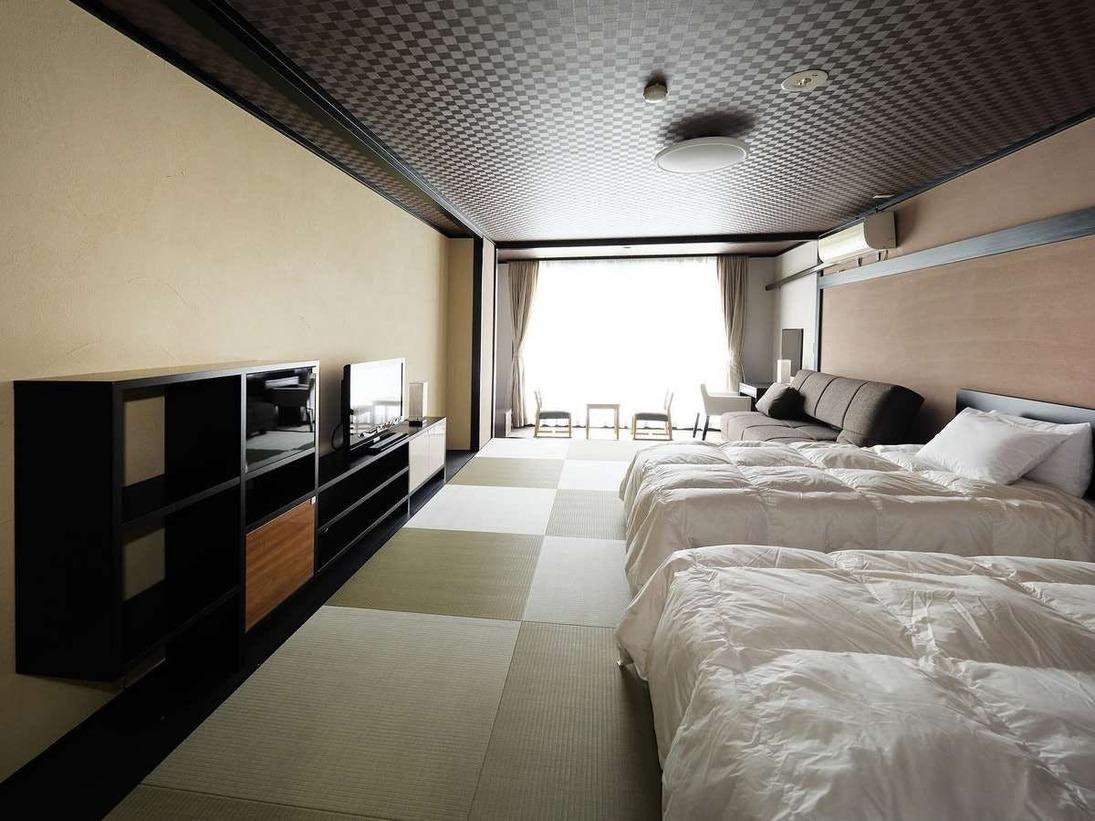 和モダンルーム 「洋室12畳」~シモンズ社製のベッド~