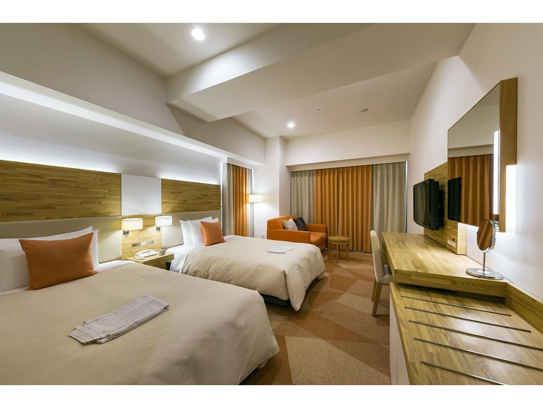 デラックスツインルーム26.9平米/シモンズ社製セミダブルサイズベッド、幅120cm