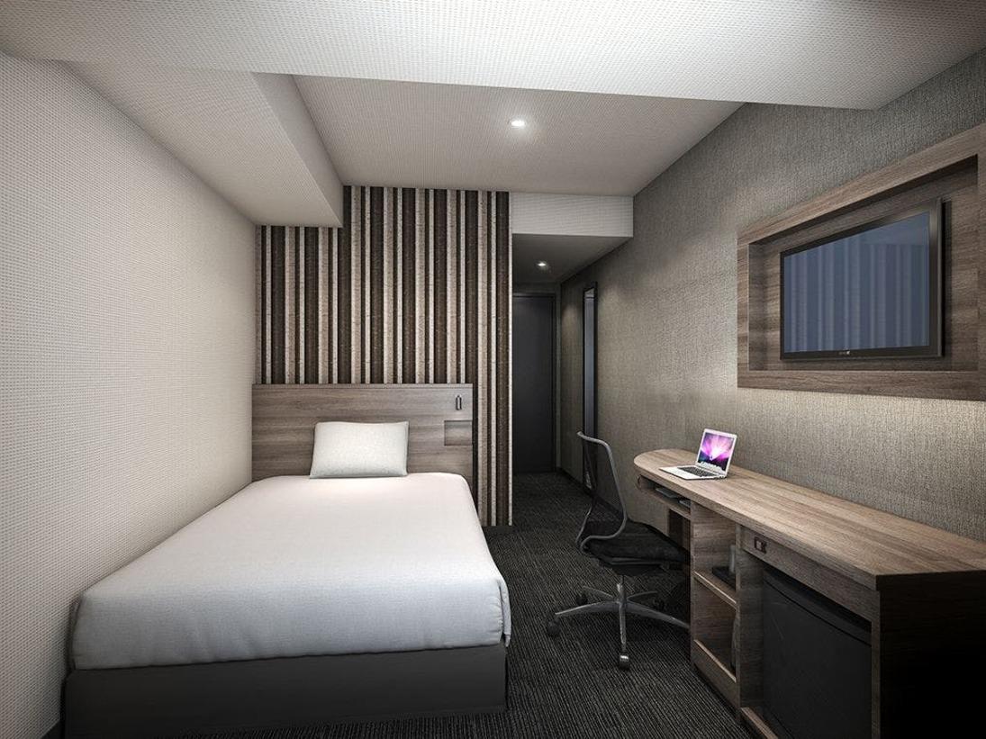 ゆったりとした15平米の客室はダブルベッド(幅1400)1台1名様、2名様でご利用いただけます。