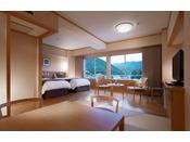 飛泉閣7階の和洋室。飛騨の木材を取り入れた、6畳の和室とツインベッドの付いた開放的な完全禁煙のお部屋。