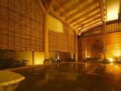 【石の露天風呂】湯出し口からそそぐ生まれたての源泉をゆったりとお愉しみください。