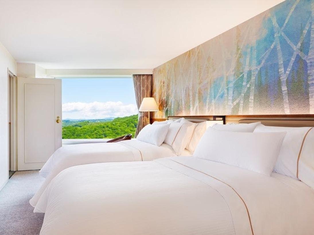 【全室メゾネット】客室例/ベッドルーム:WESTIN特製ヘブンリーベッドとともに心地よいお目覚めを