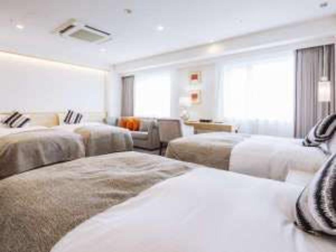 西館ファミリールーム(一例)(※3名様利用時は、ベット3台のお部屋となり、写真とは異なります。