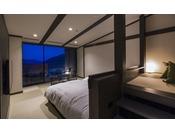 夜の最上階露天風呂客室