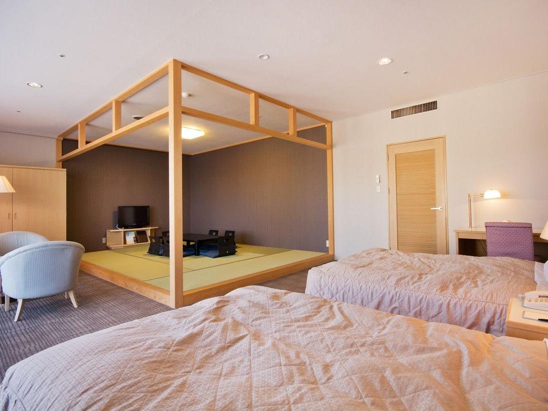 【和洋室】ツインベッドの洋室と畳のスペースを備えております。