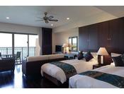 ホテル棟スイート(3~10階)62~78平米※客室は一例となります。フローリング仕様の部屋は小さいお子様連れでも安心です。正規ベッドを4台備えたお部屋となっております。ベッドサイズ/120cm×200cm