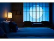 モデレートツインルームの障子に月の様に浮かぶ「円」が美しい。