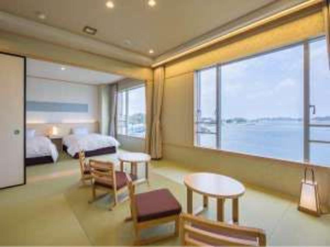 望館 和室二間続きの客室にツインベッドの和風モダン調のお部屋。