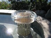 庭園露天風呂では、真珠を埋め込んだお湯受けが太陽の光を受けてキラキラと輝きます。