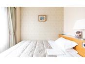 エコノミーシングルルーム15平米幅120cmのベッドを使用 ※写真は一例です