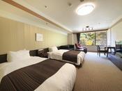 <本館洋室タイプ> 当館下層階の客室です。 シモンズ製シングルベッド2台とマッサージソファーを設置しています。 ※各フロア1室