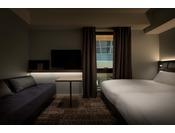 16平米・95cmシモンズベッド3名利用も可能なお部屋。2名利用時はソファーを備え付け。
