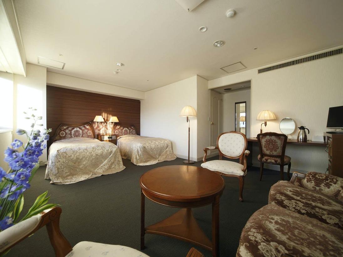 ダブルベット2台広々とした癒しの空間でお寛ぎいただける、ちょっと贅沢なツインルーム(デラックス=豪華・高級・贅沢の意味)