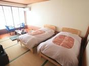 ベッドタイプのお部屋一例です