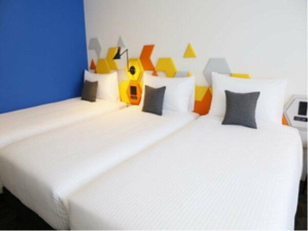 スーペリアトリプル。シングルベッドが3台のお部屋になっております。(ベッド間には隙間がございます。)