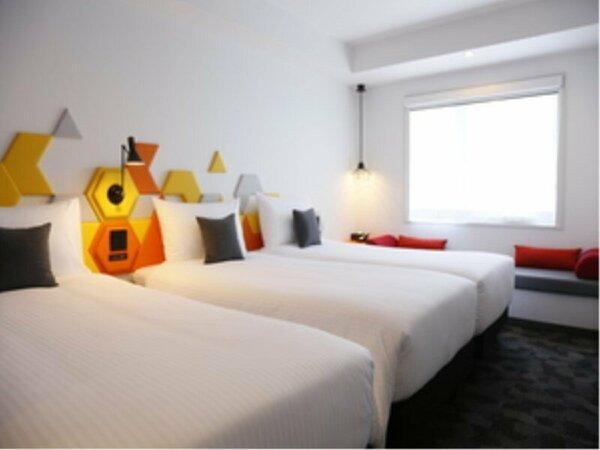 スーペリアトリプルルーム。こちらはシングルベッドが3台あるお部屋タイプとなっております。
