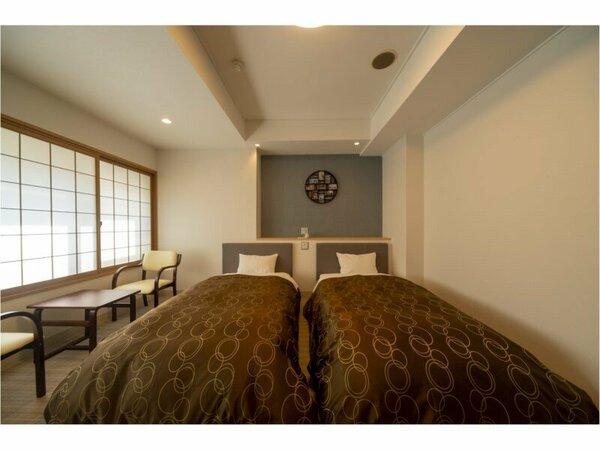 ツインルーム。落ち着きのある和モダンタイプのお部屋です。