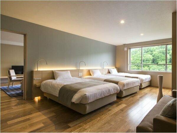 【レディースプレミアム】ベッド3台が横に並ぶ寝室。リビングと合わせ76のゆとりの広さです。