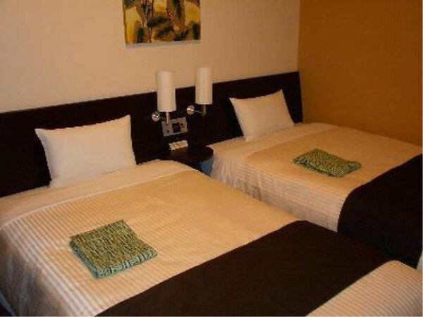 ツインタイプのお部屋の一例です。ビジネスはもちろん、ご夫婦やカップルでご利用いただけます。