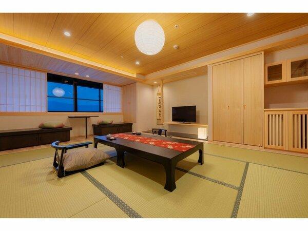 【天誠】リニューアル和室10畳:土佐ヒノキを使用した癒しの和室。窓側からは高知城下の景色も愉しめる。