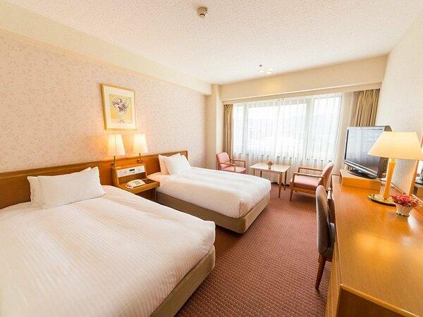 上層階スタンダードツイン:25.2平米 200cm×110cmのベッド2台 11階以上のハイフロア客室
