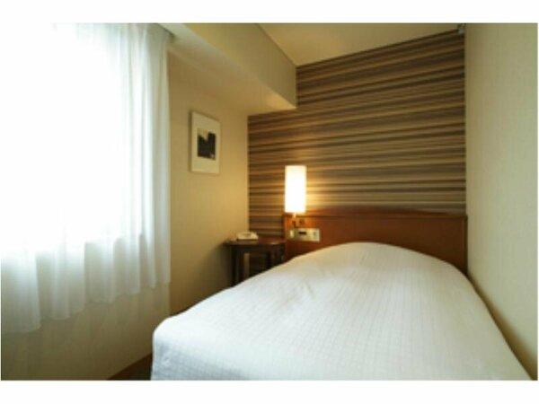 スタンダードシングルルーム。ベッドサイズ 123cm×197cm