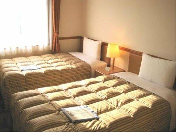 家族連れに人気のツイン!¥6980(税込)~大人2名に小学生のお子様の添い寝は無料です。