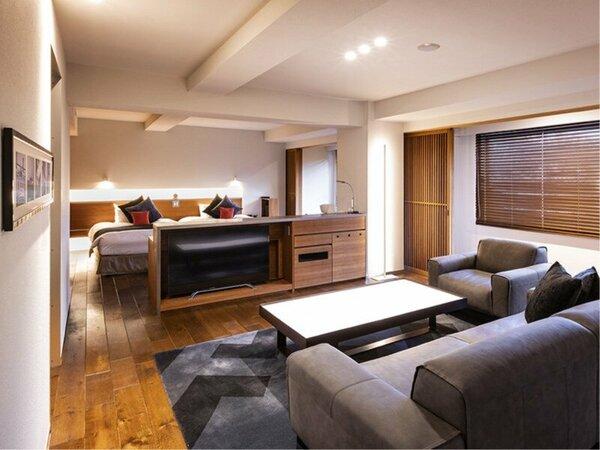 【ラグジュアリースイート和洋室】スタイリッシュなデザインのベッドルームとリビングルーム