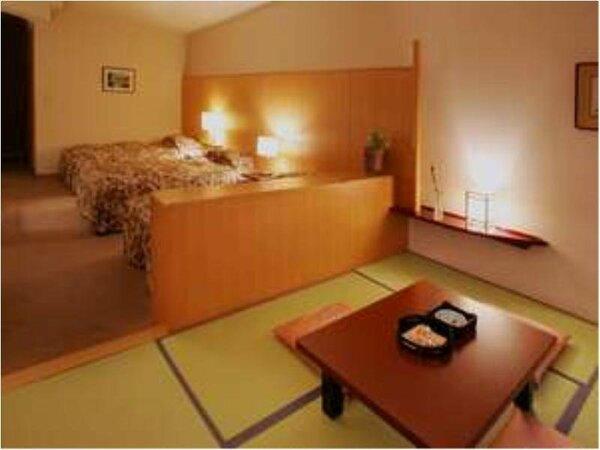 【中央館・和洋室】ゆったりベットが3台設置と和室の空間