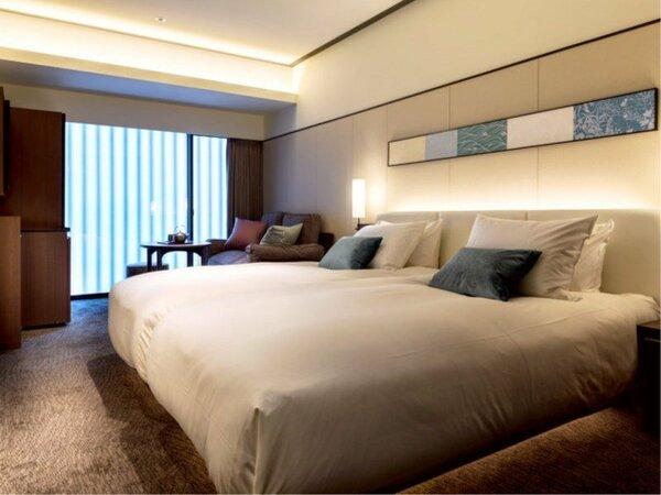 【スタンダードツイン】ベッドが2台密着して並んでいるのでお子様連れに最適です