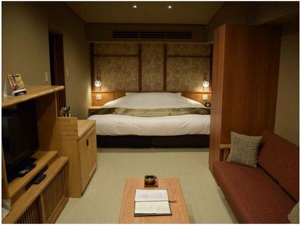 横幅たっぷりキングサイズのベッドを擁したニタイDXダブル