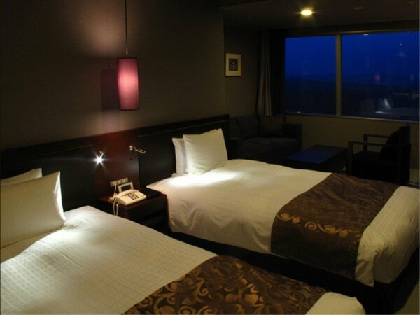 アネックスタワー:絆ツインルーム◆ 段差の無い、琉球畳敷きのお部屋でごゆっくりお寛ぎ下さい。