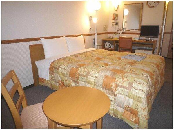 広々お部屋と大きめベッドで快適にお過ごしください。