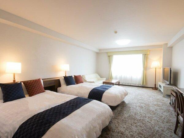 客室最上階フロア「トリプルルーム」は 上質な眠りを提供する「シモンズベッド」を使用