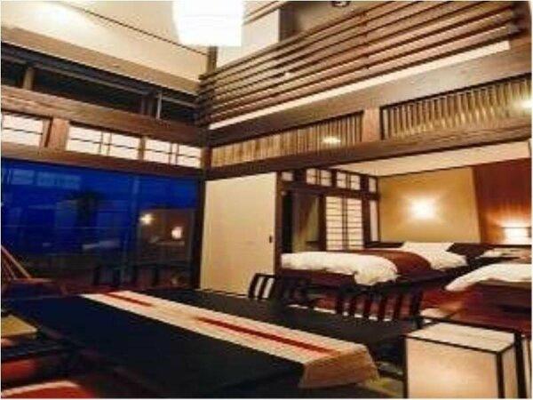 【露天風呂付客室(和洋室)】洋室ベッド2台+和室6帖です。和も洋もお楽しみ頂けます。