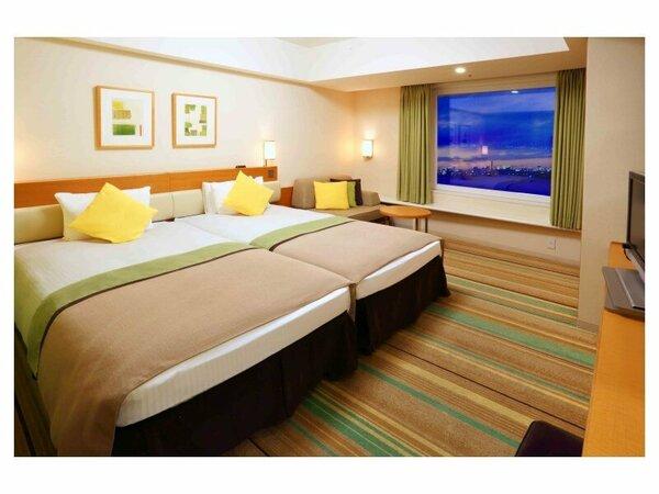 ハーモニールーム(3-9階/32平米)やすらぎのグリーン色の客室