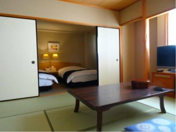 和洋室(広さ43.5平米/ベッド幅124cm+布団)