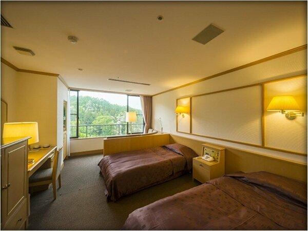 落着いた雰囲気の静かな別館「ことほぎ」ツインベッドルーム
