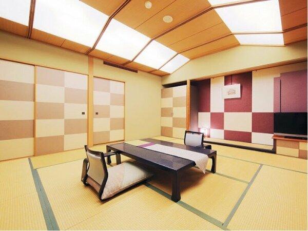 【リニューアル・広々デラックス和室(12.5畳・禁煙)】統一感のある市松模様と落ち着いた赤が特徴。