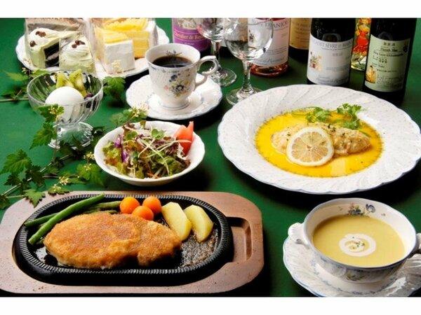 ディナーは熱々の鉄板で運ばれる肉&魚の[Wメイン」洋食フルコース