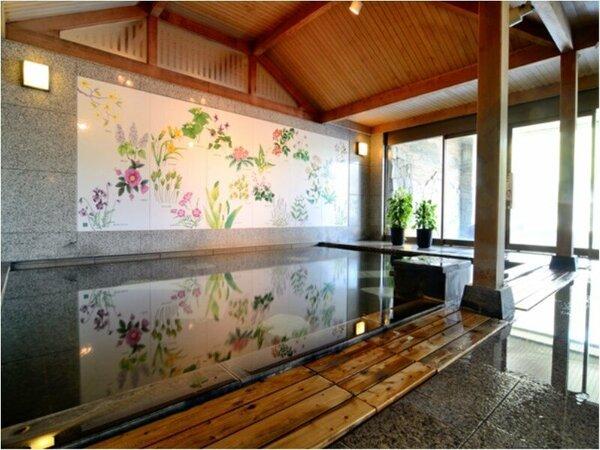 女性浴場には癒しの草花が描かれている場所が。
